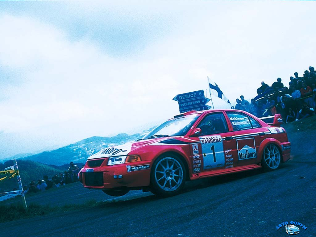 1999_Mitsubishi_LancerEvolutionVIGroupA2.jpg